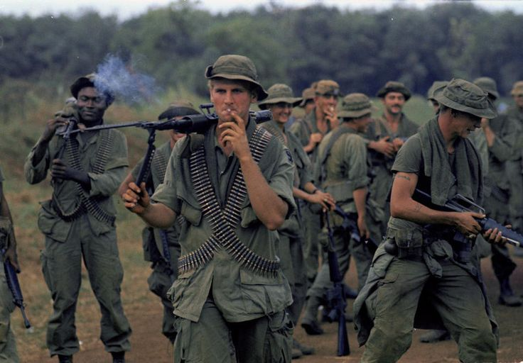 U.S. infantrymen of the 199th Light Infantry Brigade are seen on a joint Vietnamese/U.S. patrol near coffee and rubber plantations 50 miles northeast of Saigon, Nov. 29, 1969. (AP Photo/Horst Faas)