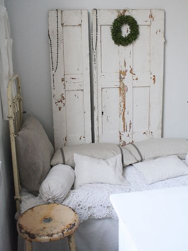 love the idea of  an old door just leaning against the wall.