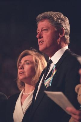 President Clinton and First Lady Hillary Rodham Clinton sing hymns along with the choir during the memorial service honoring those who died in the bombing of the Alfred P. Murrah building, 4/23/1995. Photograph from the William J. Clinton Presidential Library.