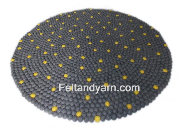 Handmade felt ball rug from Nepal. This beautiful felt ball rug is made with…
