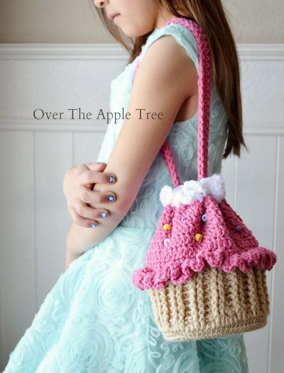 This listing is for a girls crocheted cupcake purse. This cute cupcake bag is the perfect size to carry all her important stuff! This cupcake would make a great birthday gift! Bag has a drawstring to close as well as a comfortable shoulder strap.The bottom measures 5 inches in diameter and its approximately 7 inches tall. The bottom is reinforced with flexible plastic for sturdiness and to help bag hold its shape. Purse is made with acrylic yarn and plastic beads for the sprinkles.  This…