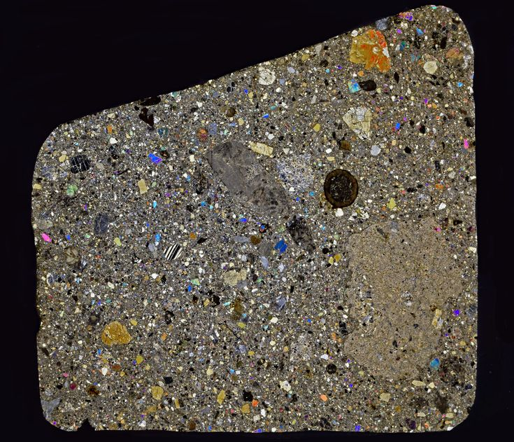 Northwest Africa 6067 Classification: HED achondrite (Eucrite, polymict)  The meteorite is a fresh polymict breccia composed of eucrite clasts, melt clast with different quenching textures and mineral fragments embedded in fine grained matrix. Mineral phases are exsolved pyroxene, calcic plagioclase and sparse grains of diogenitic orthopyroxene. Accessories include silica polymorph, ilmenite, chromite, and troilite.