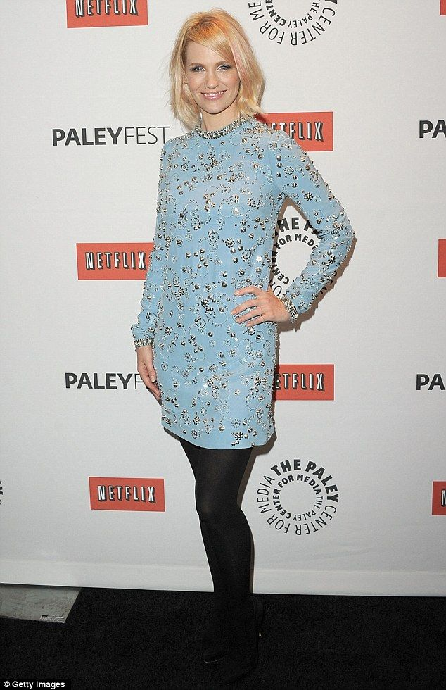 Beautiful in blue: January channelled the series' Sixties setting, slipping her post-pregnancy figure into a powder blue embellished mini dress