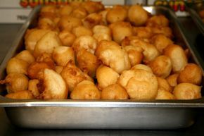 This Chinese recipe for puffed crisp chicken balls uses boneless, skinless chicken breasts cut into 1 by 2 inch pieces and marinated with five-fragrance powder. The pieces of chicken are then dipped in a thick batter made with sesame seeds and minced scallions. Then they are deep fried and served with soy-vinegar dip.