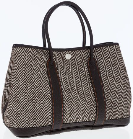 A Hermes Ebene Buffalo Leather And Ecru Chevron Wool Garden Party Tote Bag With The