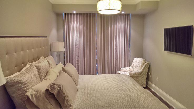 Elegant draperies in a downtown condo bedroom
