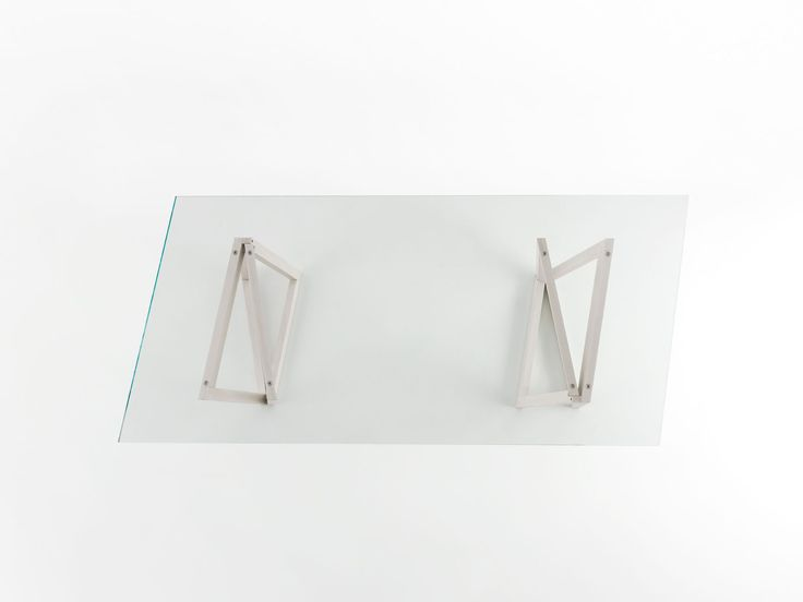 """QUADROR 02 / Design: Dror, 2015 / QuaDror 02, or creatively better: an extraclear tempered glass top supported by an essential structure, consisting of four identical elements in an """"L"""" shape (in raw metal or oilstained ashwood) which intersect with each other. The result is an elegant and light table, capable of embellishing any environment by becoming its centrepiece."""