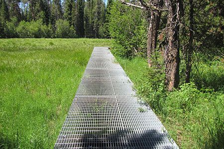 Metal grate walkway over a marsh grand teton national for Metal garden bridge designs