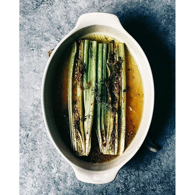 Whole Celery Braised With Thyme And Stock. Get this and 60+ more Meatless Monday recipes at https://feedfeed.info/meatlessmonday