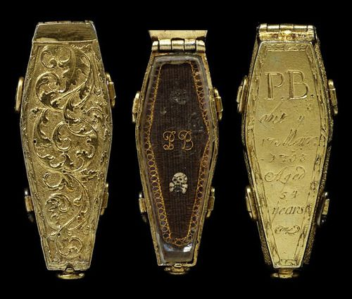 Coffin pendant with woven hair inside, made in England, 1703