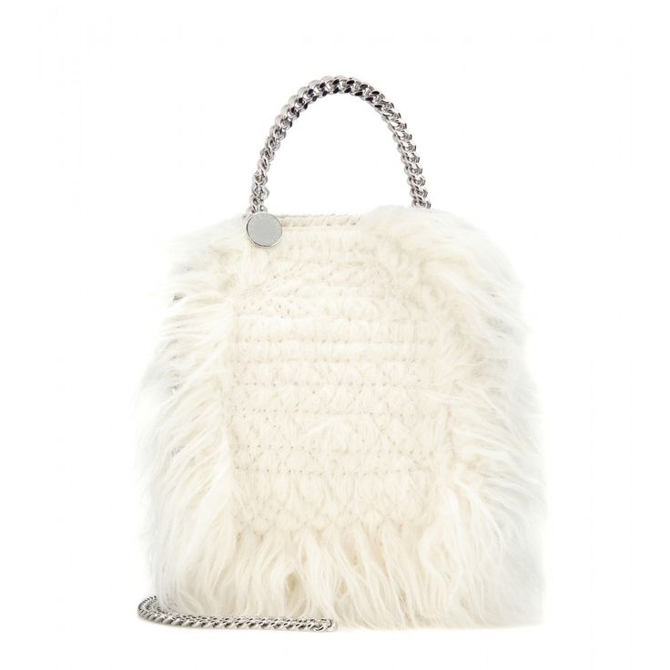Stella McCartney - Tiny Falabella faux fur shoulder bag - Stella McCartney's 'Falabella' has become an It bag among the fashion pack. This 'Tiny' version has just enough room for all your everyday needs, with both a top handle and a shoulder strap for versatile styling. Try this ivory faux fur style next to bright colours for a cool contrast. seen @ www.mytheresa.com