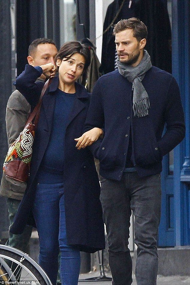 Expecting: Jamie Dornan and wife Amelia Warner, pictured in mid-October, are said to be ex...