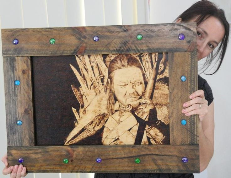 Original artwork of Ned Stark, depicted sitting on the Iron Throne.  Original artwork is hand-burnt onto plywood, framed, and then finished with natural shellac.