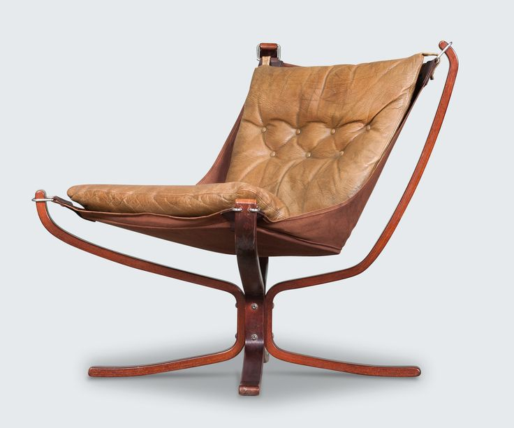 The Low Back Falcon Chair is an iconic Norweigian design piece. Originally designed in 1971 by Sigurd Resell and manufactured by Vatne Mobler Norway. With a light appearance, hammock style seat, vintage leather cushioning and solid wood frame, this impressive piece is as beautiful as it is comfortable and supportive. This falcon chair has a button free style cushion in a luxurious tan leather.