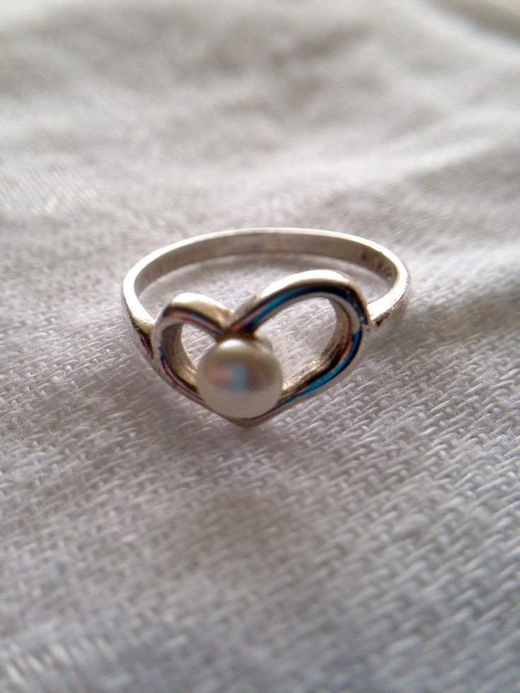 A personal favorite from my Etsy shop https://www.etsy.com/ca/listing/487864119/silver-heart-ring-with-pearl