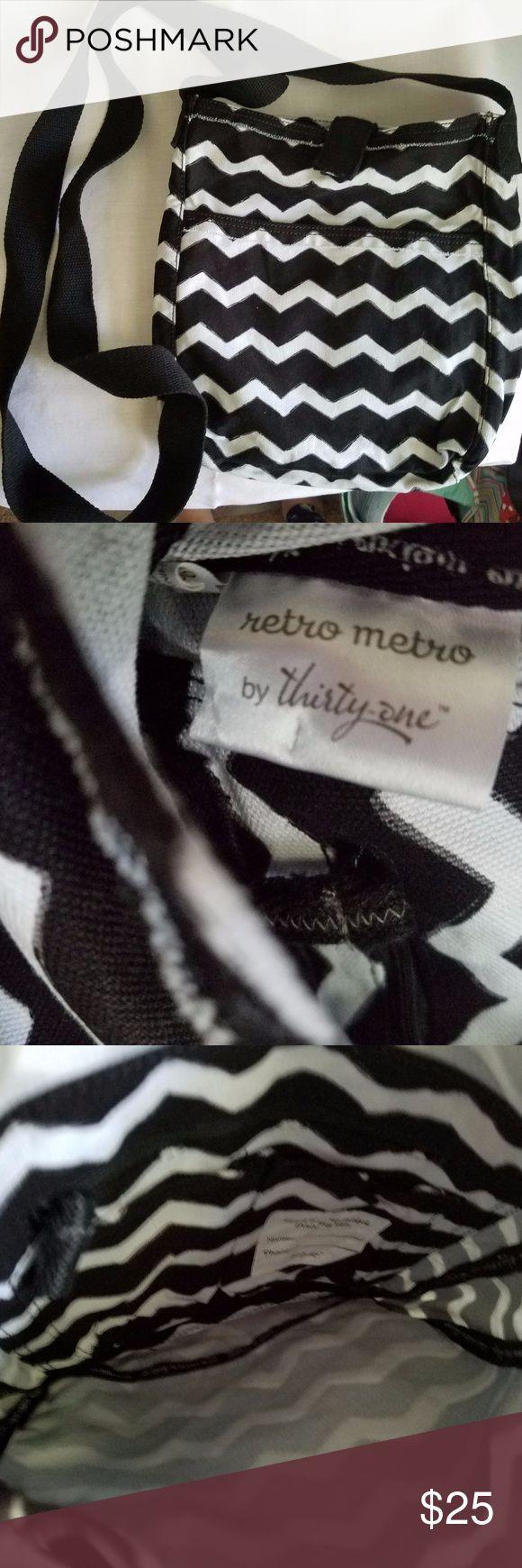 NWOT Retro Metro Crossbody NWOT. Long crossbody bag. Black and white chevron. Never used. Thirty-One Bags Crossbody Bags