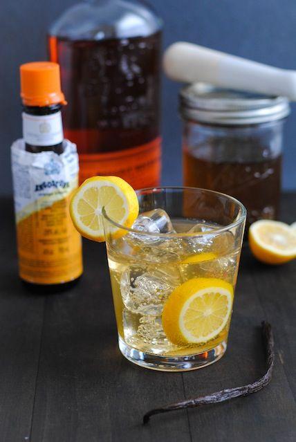 Meyer Lemon-Vanilla Bean Bourbon Smash: 1/4-inch-thick slice of Meyer lemon Ice 2 ounces bourbon 1 ounce Vanilla Bean Simple Syrup 4 dashes orange bitters Club soda