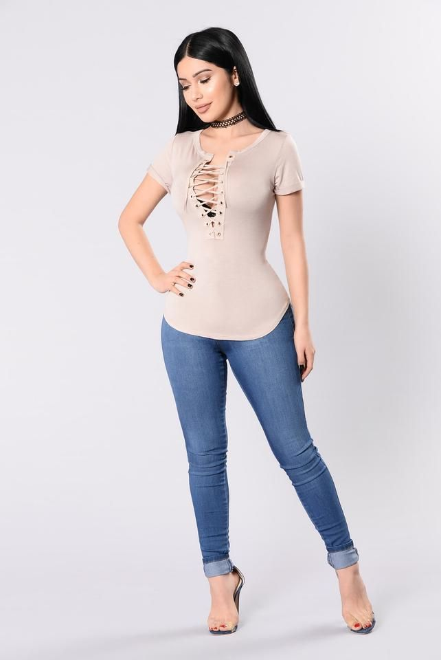 - Available in Nude - Short Sleeve Top - Cuffed Sleeve - Lace Up Font - Small Gold Grommets - Made in USA - 95% Rayon 5% Spandex