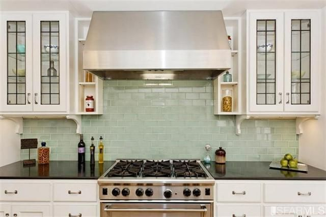 hood and shelves; sea glass subway tiles | kitchen by Jerome Buttrick via Remodelista.