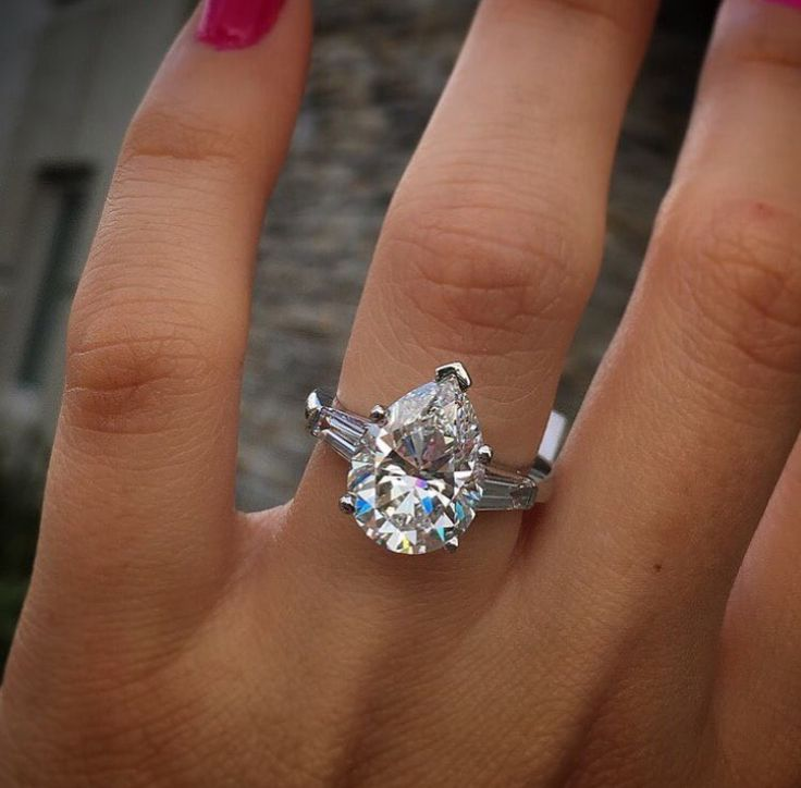 This pear shaped ring is impressive. I think I'd do something more like this one