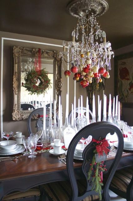 Ornaments hanging from a chandelier with ribbon