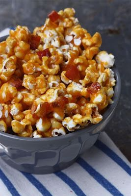 Spicy Caramel Bacon Popcorn - What I love about this popcorn recipe is that the bacon bits are added to the caramel, so they're coated, too! That mixture is poured over the popcorn. This means the bacon is, like, stuck to the popcorn. AWESOME.