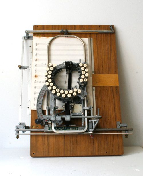A music typewriter. I think I really need one of these!    OMG...never seen one of these before!