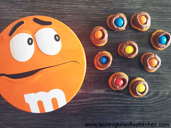 Mini Gluten Free Pretzels, Caramel Rolos and M&Ms make up these wonderful, delicious treats. If you love sweet and salty combinations then these M&M Rolo Pretzel Bites are for you.