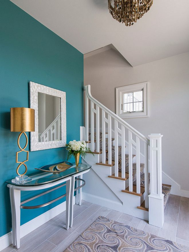 "The accent wall paint color is Benjamin Moore Mayo Teal CW 570. The remain walls are painted in ""Benjamin Moore Intense White OC-51""."