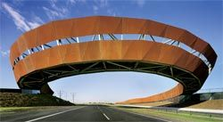 Driving away from the city, with the rusting Corten steel bridge arcing overhead. Image: John Gollings