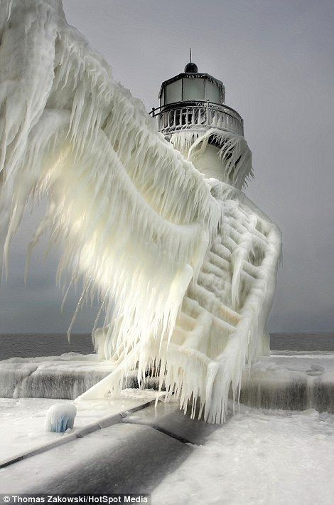 "Frozen Lighthouse in South Haven, Michigan | Thomas Zakowski/HotSpot Media, via Daily Mail. ""Standing in temperatures well below freezing, this Michigan lighthouse has been transformed into a giant icicle."""