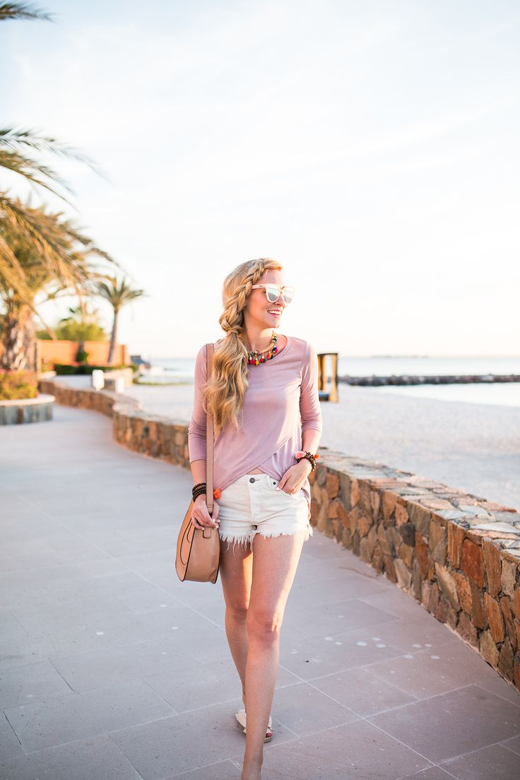 A Pinch of Lovely - Pink long sleeved tee+white jean shorts+nude bow slides+cognac crossbody bag+necklace+bracelets+sunglasses. Spring Casual Outfit 2017
