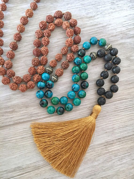 108 Bead Mala Necklace made from 8mm Rudraksha Seeds, Chrysocolla and Lava Stone beads. Necklace measures 37 around. Gemstone Properties: Chrysocolla ~ is said to be a stone of communication. It discharges negative energies, calms, and allows truth and inner wisdom to surface and be