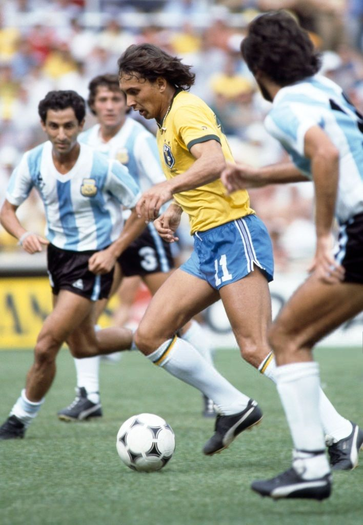 Eder of Brazil, watched by Osvaldo Ardiles of Argentina , during the FIFA World Cup match between Argentina and Brazil at the Estadio Sarria in Barcelona, 2nd July 1982. Brazil won 3-1.