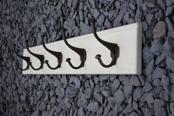 Beautiful coat rack with five heavy lined antique style coat hooks.