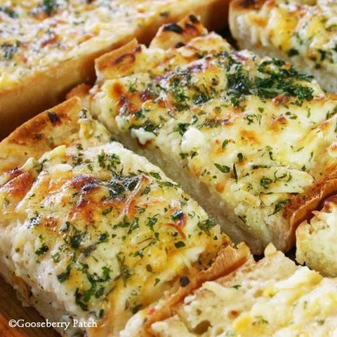 Bubbly Cheese Garlic Bread - 1/2 C soft butter, 1-2 cloves crush garlic, 1/2-1 C creamy Italian salad dressing,  2 halves Italian bread, 2 C shred Cheddar, mozzarella or Monterey Jack cheese, 2 tsp dried parsley. Blend butter, garlic, salad dressing together in a small bowl. Place bread on sheet pan. Spread butter mixture over both halves. Top with shredded cheese and parsley. Bake, uncovered, 375 :10-20 min, until cheese is melted and bubbly. Slice each half into 8 pieces. 16 servings.
