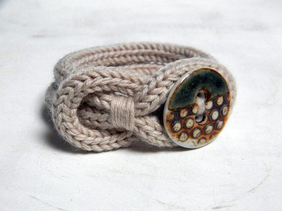 Knot bracelet, neutral beige wool and porcelain bracelet. Knitted jewelry. Knit bracelet. Seagreen and rust.