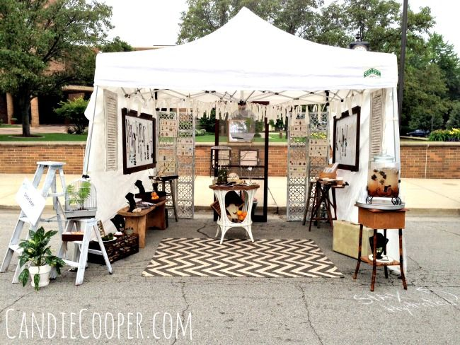 Love the rug in this craft show tent and the use of white and wood display props and fixtures.