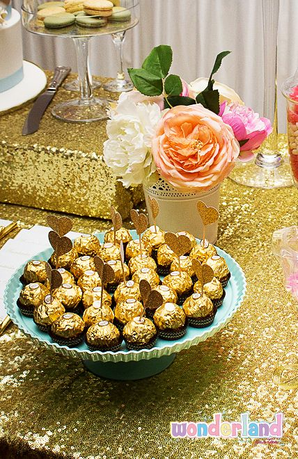 Gold heart toppers decorated on ferrero rocher chocolates - http://www.wonderlandparties.com.au/
