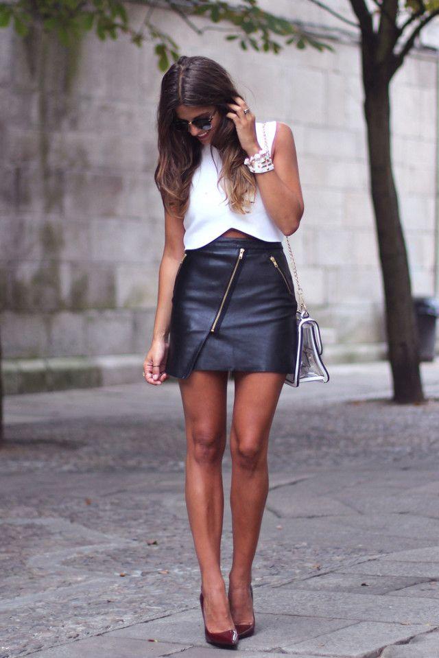 Natalia Cabezas is wearing an asymmetrical leather mini skirt