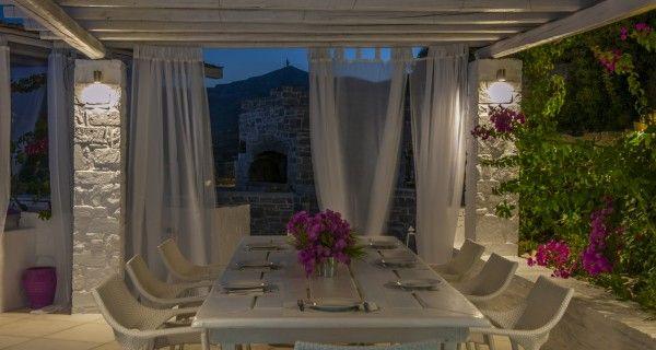 Outdoor Dining table of Moonlight Villa in Paros Greece. http://instylevillas.net/property/moonlight-villa-paros/