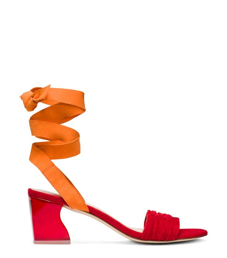 Stuart Weitzman SWIFTKEEL. We're over the rainbow for these statement sandals which pair a Lucite block heel – a SW signature — with a ruched vamp. Wide ankle-wrap straps crafted from sumptuous suede in a contrasting hue lend a color blocked effect. Wear with fluid culottes or an accordion midi skirt. Made in Spain.