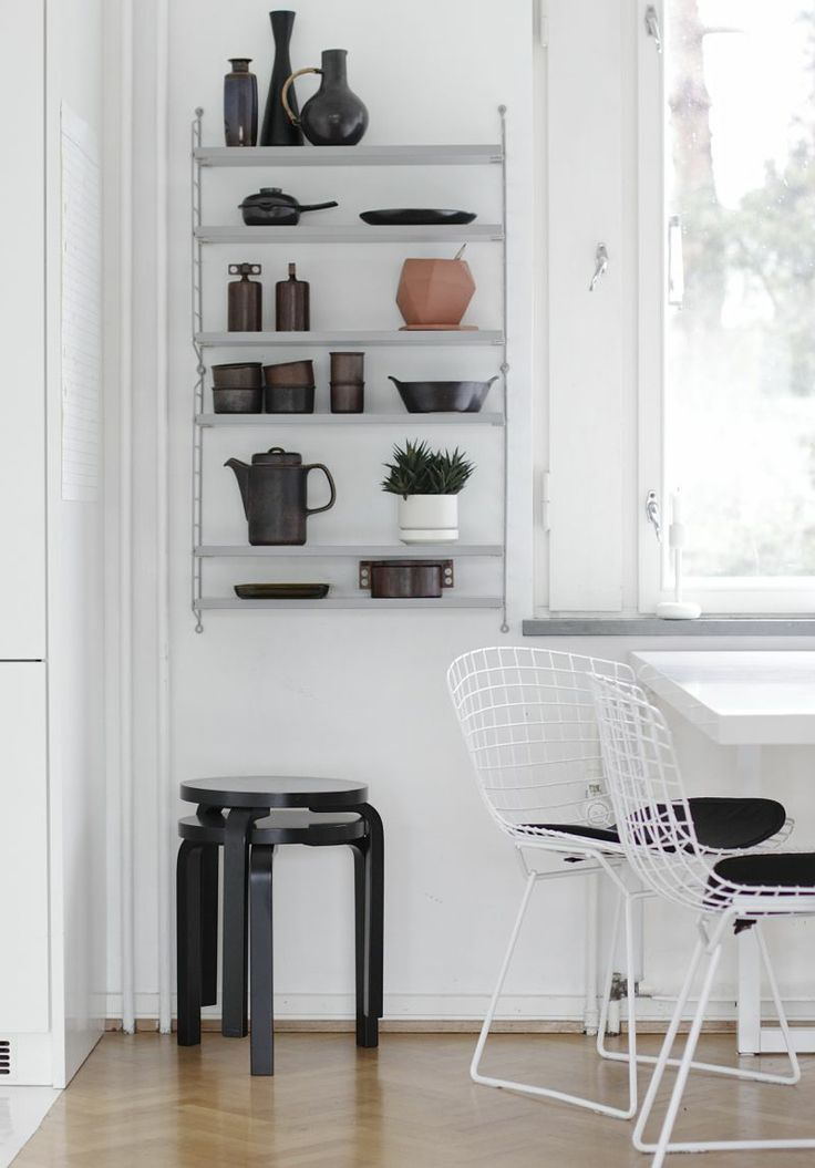 Modernism with a collectors charm. Aalto stools, Bertoia chairs and String shelving with a lovely array of objects.