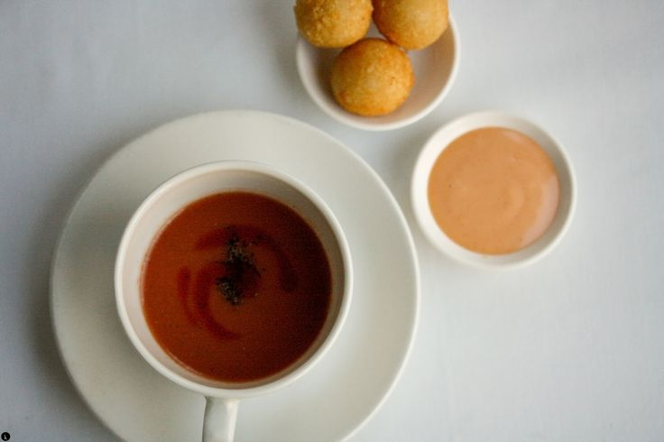 Chilled tomato gazpacho smoked herb oil, truffle and cheese croquettes at La Mouette, Cape Town