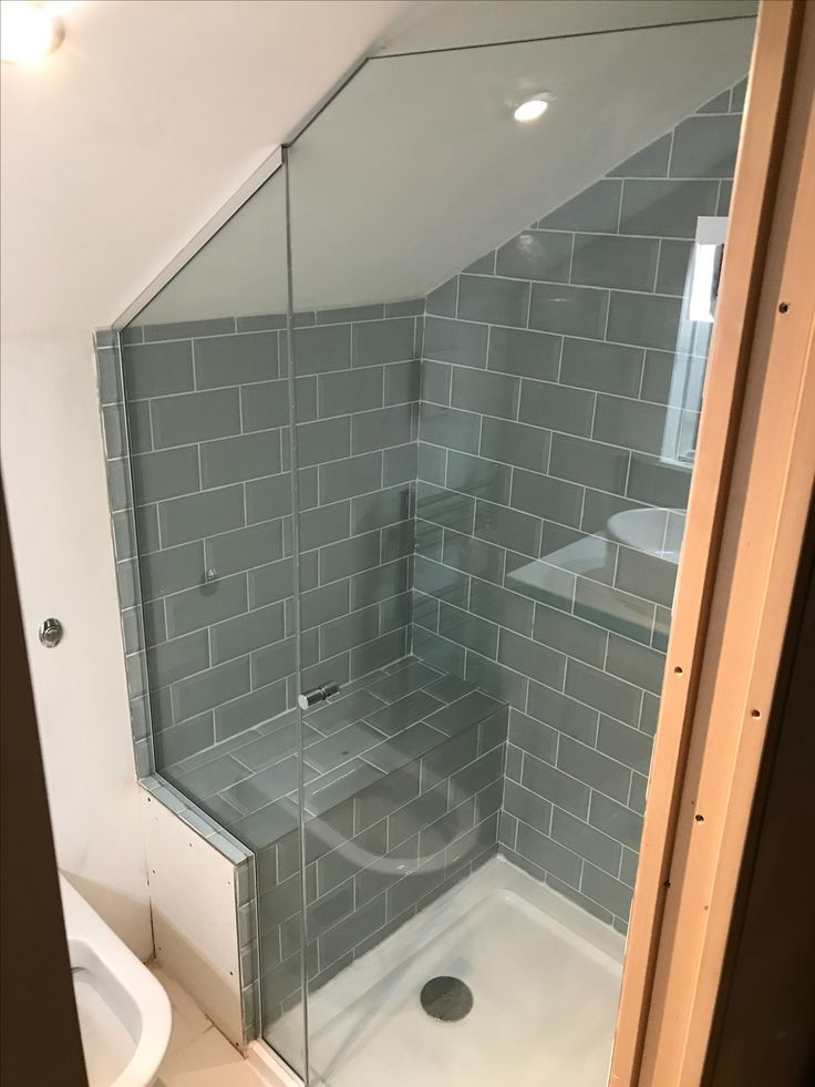 Fully frameless shower enclosure installed into lo…