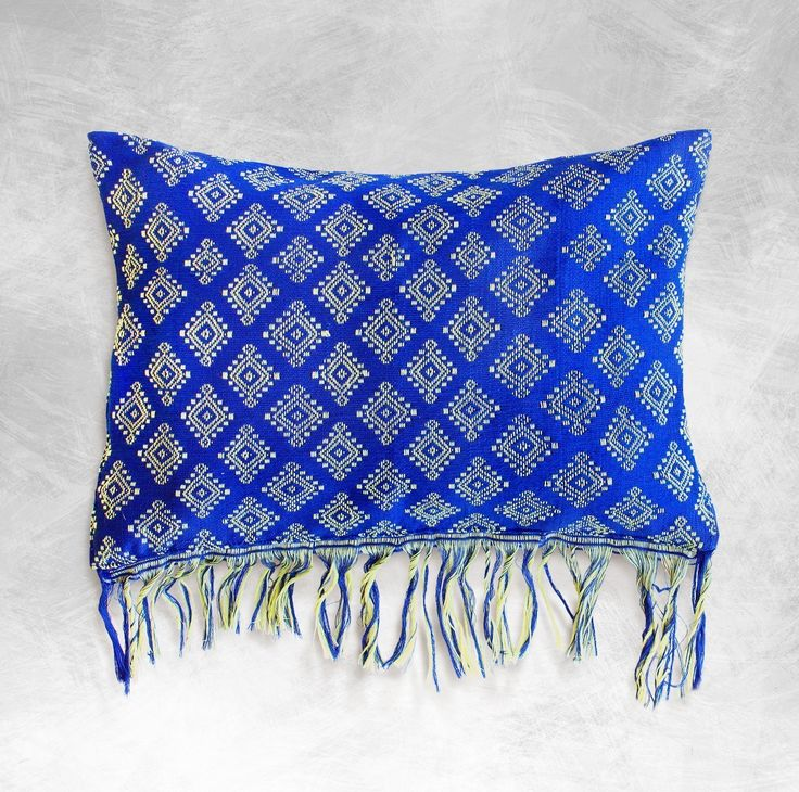 Indigo Boho Ikat Pillow Cover, 12.5 x 18 inch, Rectangular, Blue, Cotton, Bohemian, Pillow Shams, Cushion Cover, Throw Pillow, Pillowcase, Pillow Shams, Decorative Pillow, Lumbar Pillow, Sofa Pillow. • This stunning tropical pillow is made from Sumba's traditional hand-loomed fabric by talented Sumbanese artisans. In Sumba, these fabrics are worn on their shoulders as symbol of status. • This pillow is very soft and comfortable, perfect to be used as bedroom and livingroom's pillow. • It…