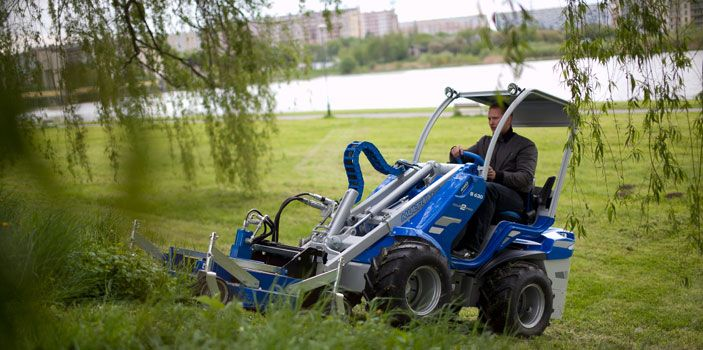 "MultiOne Multipurpose loader with lawnmower attachment. Find us on www.multi-one.co.za and facebook ""MultiOne SA"""