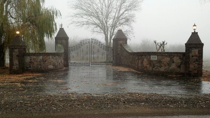Driveway Gate Stone Columns Black Wrought Iron Gate