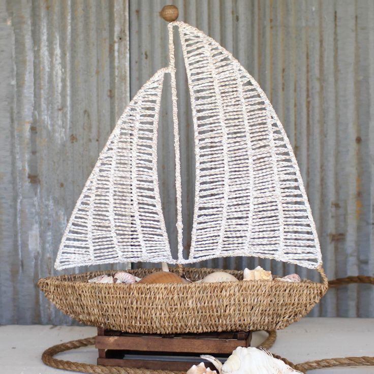 Add a windswept touch of the nautical to your décor. Crafted from seagrass, this woven sailboat is a piece of art you can use to adorn your mantel, bookcase, or dresser.  Find the Woven Sailboat Accent, as seen in the Modern Coastal Wedding Collection at http://dotandbo.com/collections/modern-coastal-wedding?utm_source=pinterest&utm_medium=organic&db_sku=90188