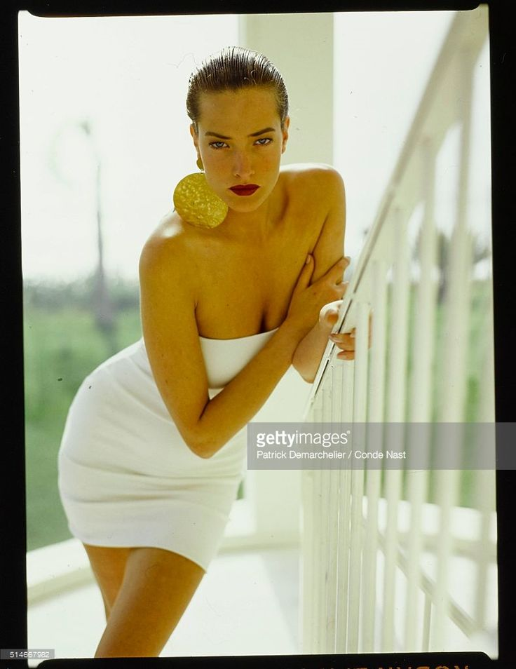 News Photo : Model Tatjana Patitz in a strapless white dress...